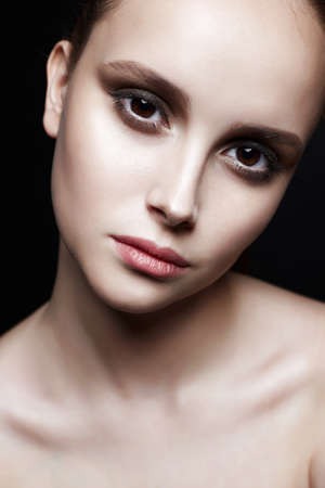 beautiful girl with big brown eyes. young woman with clean skin face. Beauty Fashion Portrait 写真素材