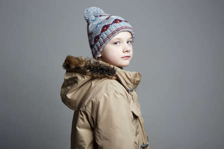 Fashionable Boy in winter outerwear. fashion kid. child. stylish teenager in knitted hat Stockfoto