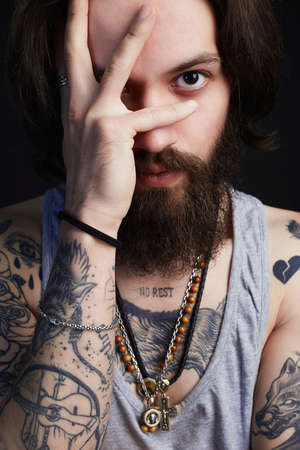 portrait of handsome man with beard and tattoo. bearded hipster boy