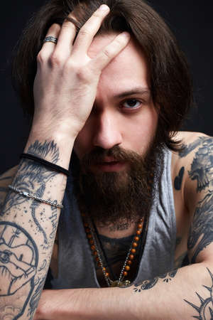 handsome man with beard and tattoo. bearded hipster boy