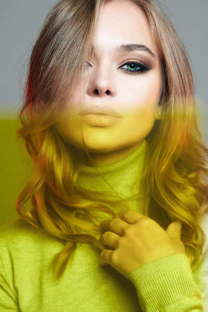 Beautiful woman in yellow color film. amazing curly girl. color beauty fashion portrait Banco de Imagens