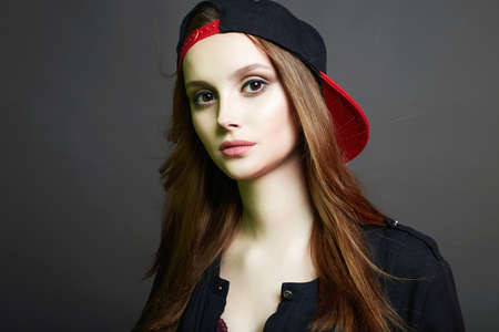 Fashionable beautiful Girl in Cap. Teenager style pretty young woman
