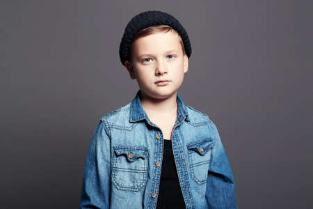 portrait of child. handsome little boy in jeans and hat. 10 years old kid
