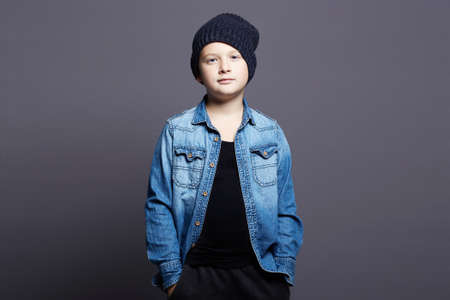 portrait of stylish child. smiling little boy in jeans and hat. 10 years old kid
