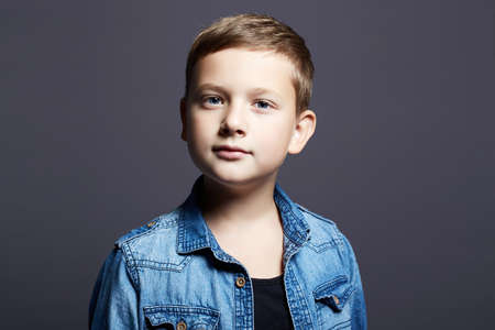 portrait of child. handsome little boy in jeans. 10 years old kid