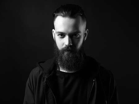 Black and white portrait of Man. Bearded Handsome Boy. Stylish hipster