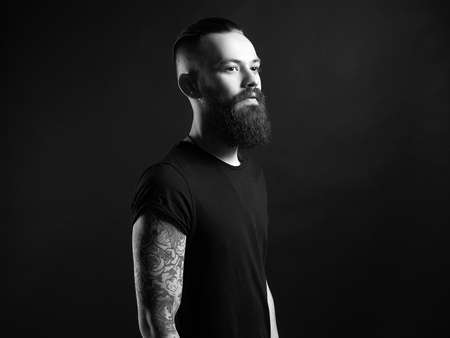 Boy with stylish haircut and tattoo. handsome Man black and white portrait
