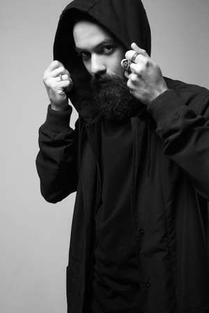 Fashionable Man In Hood. Bearded Handsome Boy. Stylish hipster