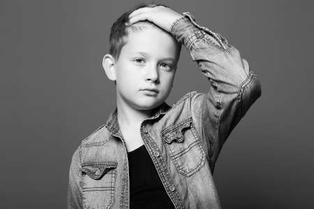 fashion portrait of child. handsome little boy in jeans. 10 years old kid