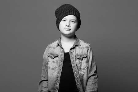 fashion portrait of child. handsome little boy in jeans and hat. 10 years old kid