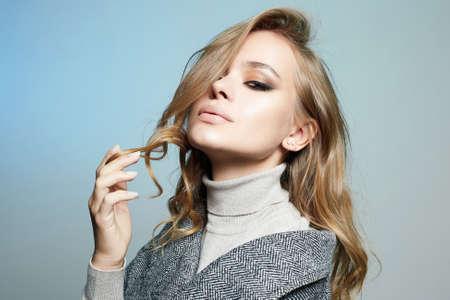 Fashionable beautiful Woman. Beauty Fashion Girl in topcoat. winter Shopping