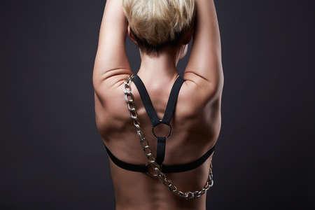 Female Back with steel Chain. sexual Beautiful body blond woman. sexy body girl weared swordbelt Zdjęcie Seryjne