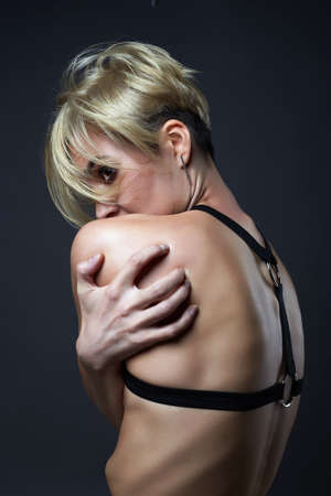 Female Back. sexual Beautiful young blond woman in underwear. sexy body girl weared swordbelt