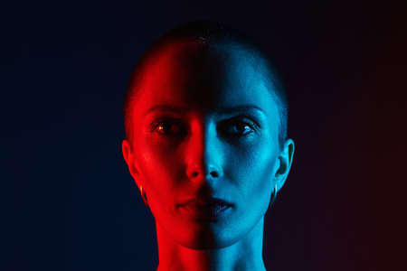 bald old woman head in color lights. Art colorful portrait with radiance face