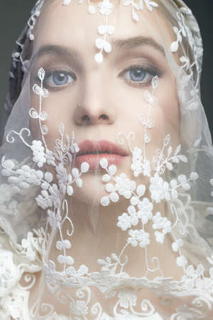 bride under a veil. Sensual beautiful young Woman. beautiful female lovely Face