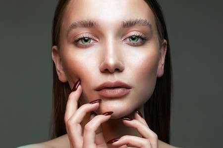 Fashion beauty portrait. girl with green eyes. Beautiful young Woman with makeup