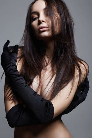 Beautiful Naked Girl in long Gloves. Sexy Beautiful Young Woman with perfect body Standard-Bild
