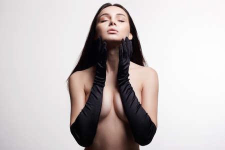 Naked Body Girl in gloves. Sensual Nude sexy Beautiful young Woman
