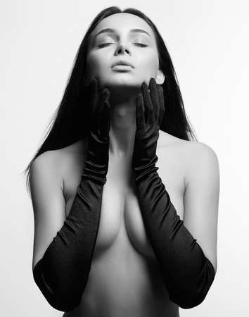 Naked Body Girl in gloves. Sensual Nude sexy Beautiful young Woman. Black and white portrait