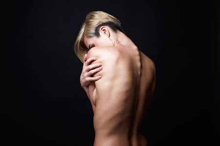 Female back. Naked beautiful Blonde Girl. Short Hair Girl with muscular back 免版税图像