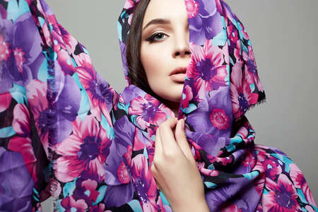 beautiful young woman in colorful flower veil. beauty girl. fashion ethnic style woman