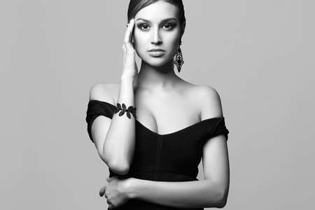 Beautiful sexy woman in jewelry. black and white stylish portrait of sexual girl