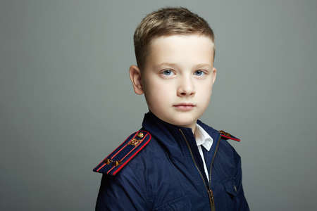 little officer. handsome boy weared in uniform. Police child 免版税图像