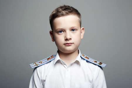 young officer. handsome boy in uniform. Police child