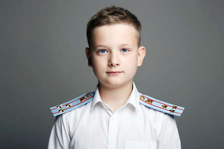 young officer. handsome boy weared in uniform. Police child
