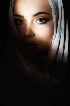 religion beautiful young woman. beauty girl in dark. fashion oriental style woman. ethnic people
