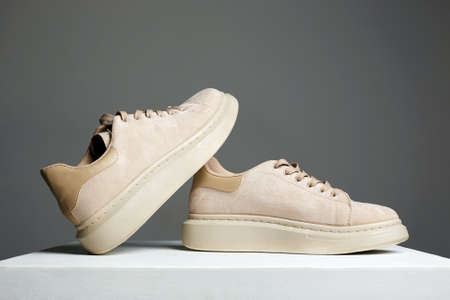 beige sneakers. fashion shoes still life. stylish photo in the studio