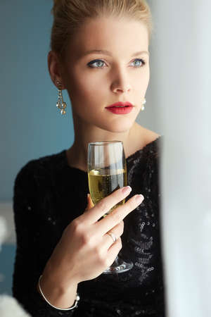 beautiful elegant woman with champagne. pretty blond girl at the party