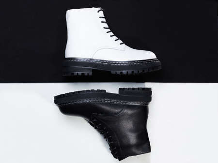black and white boots. fashion shoes still life. stylish photo in the studio 免版税图像