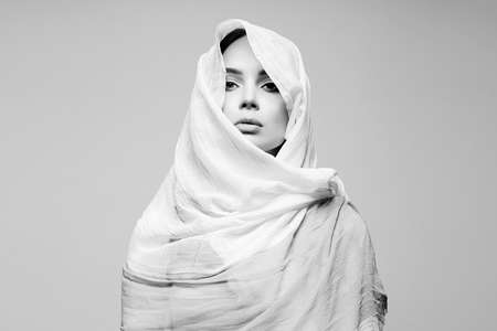 beautiful young woman. beauty black and white portrait of girl in hijab