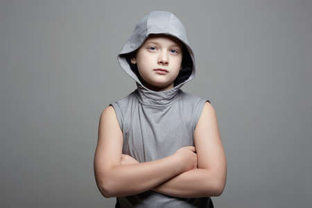 Funny Little Boy in Hood. Sport Handsome Kid. strong child