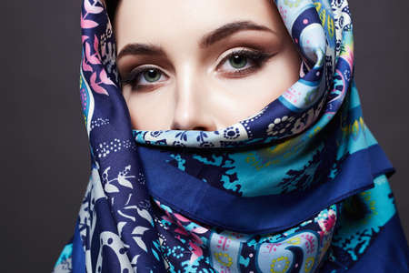 beautiful young woman in color veil. Fashionable girl in colorful hijab