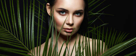 beautiful girl in palms. Beautiful woman with Make-up. Beauty Portrait. wild woman in Jungle.