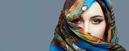 beautiful woman in color veil. beauty girl in colorful hijab. fashion islamic or indian style woman. ethnic people