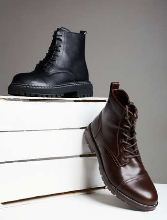 different Trendy boots with white wooden box. fashion shoes still life 免版税图像 - 158762765