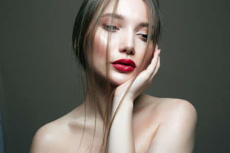 young beautiful young woman. Beauty sensual girl with red lips make-up 免版税图像