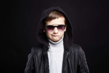 funny little boy in hoodie and sunglasses. stylish kid in leather coat 免版税图像 - 164856019