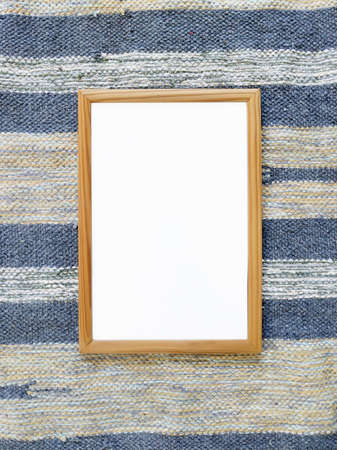 Beautiful white frame for a picture on carpet. Unusual interior photo
