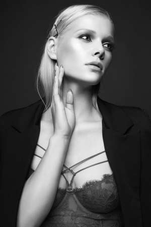 Fashionable beautiful girl with Blond Hair weared nderwear. beauty fashion sexy woman with make-up 免版税图像