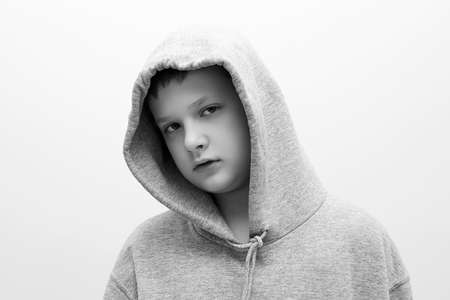 little boy in hood. Black and white portrait of stylish teenager boy. Child