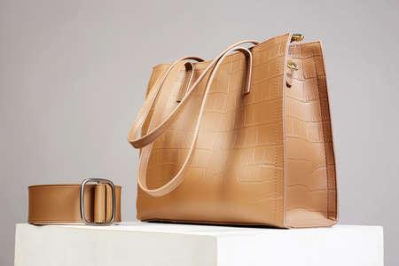 Stylish Leather Handbag and Belt. fashion still life. Female Bag