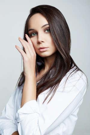 Beautiful Brunette Girl. fashion beauty portrait of beautiful woman in white shirt