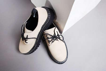 trendy beige boots. fashion shoes still life. stylish catalog photo 免版税图像