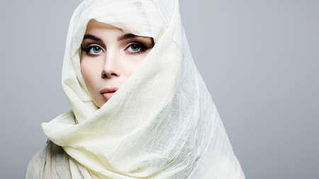 beautiful young woman in white hijab. beauty girl in sari. fashion oriental style model