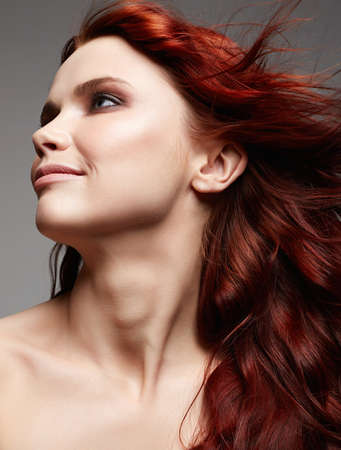 beautiful happy woman with long red hair. beauty portrait of healthy hair smiling girl
