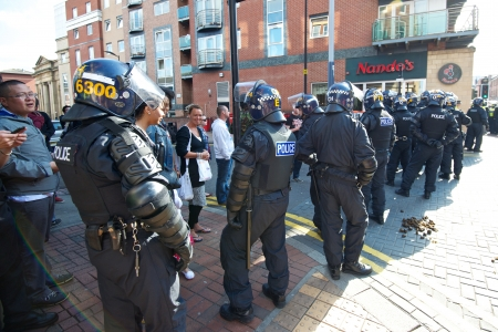 fascism: Sheffield, UK - June 8, 2013 - Riot police cordon at English Defence League and United Against Fascism protest